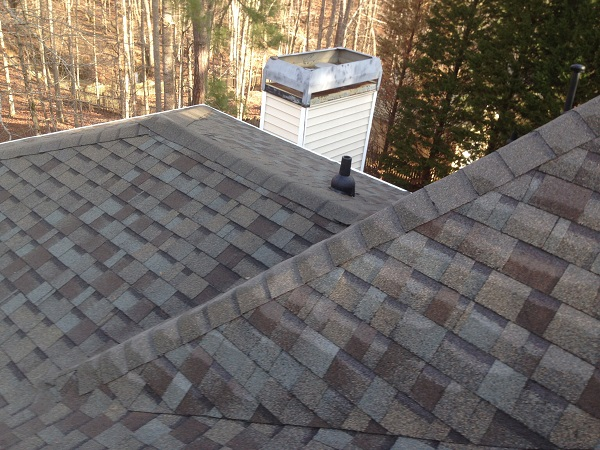 Roofers replacing a Brown Roof